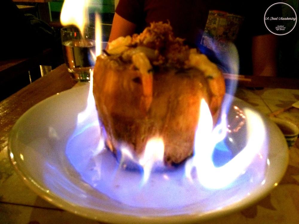 Flaming prawns in fresh coconut